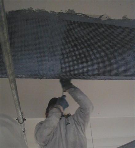 Riparazione e rinforzo di una copertura, lesionata a taglio, con l'applicazione combinata di lamine e tessuto in fibra di carbonio